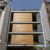 Rotating rooms give Sharifi-ha House by Next Office a shape-shifting facade