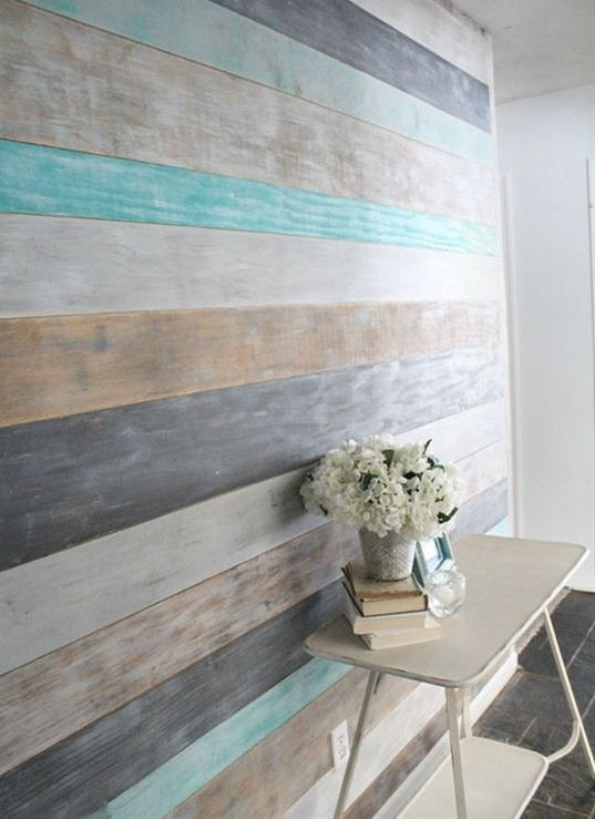 At the hardware store or at home cut sheets of four feet by 8 feet pieces of plywood into long strips. Either have all the strips cut one width such as four to six inches wide and the 8 feet long. In blue wood planked accent wall Carrie used two different sized boards, her wall used eight boards that are six inches wide and four boards that are eight inches wide. It is possible to use another type of wood board in replacement of plywood, but plywood is suggested for this project to keep the cost as a low as possible.