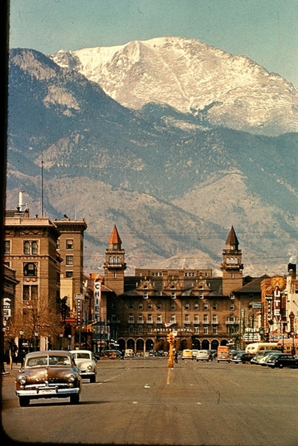 A nice vintage picture of the main street in colorado Springs with Pikes Peak in the background and the Antlers Hotel at the end of the street.