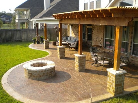 "This ""continuation"" of the back patio with the addition of the pergola is kind of what I want in our back yard. I don't want the curved area where that fire pit is though. A fire pit will be separate and in its own spot..."