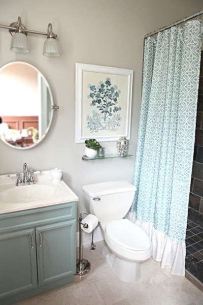 Bower Power did a great bathroom makeover on a budget. You have to see the before! The wall color is allen + roth by Valspar in Marble Tile and the vanity is allen + roth by Valspar in Park Place.