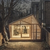 Light glows through the cedar facade of Writer's Shed by Weston Surman & Deane