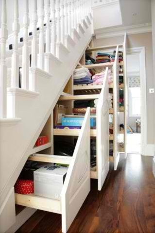 Now that's the way to use under stair storage! Closets always get creepy and webby...and underused. This idea rocks!