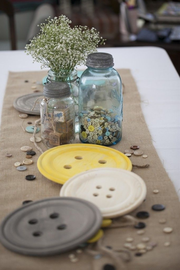 """We went with the """"cute as a button"""" theme and also combined that with a vintage feel using a lot of burlap, mason jars, and baby's breathe."""