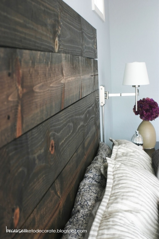headboard made from 2x4's and stained. each is individually drilled into the wall. i love this.