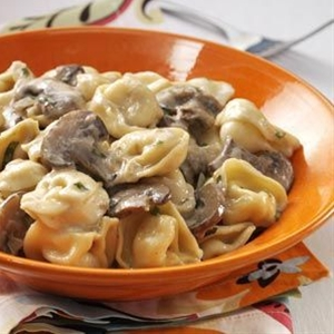 Ingredients:  1 package (19 ounces) frozen cheese tortellini,  1 pound sliced baby portobello mushrooms,  1 small onion, chopped,  1/3 cup butter, cubed,  2 garlic cloves, minced,  1 cup reduced-sodium chicken broth,  1 cup heavy whipping cream,  1/2 teaspoon salt,  1/2 teaspoon pepper,  1/3 cup grated Parmesan cheese,  2 tablespoons minced fresh basil or 2 teaspoons dried basil,