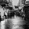 Raining in the market by Keith Mulcahy