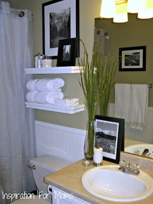 Simple remodel in the bathroom of wallpaper and picture frames & paint.
