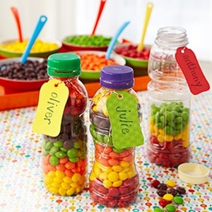 Take-home Birthday Party Treats. Layer skittles in recycled plastic bottles.
