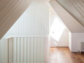 "Hampstead loft conversion by Alexander Martin features ""a new twist on the hidden library door"""