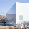 Thomas Phifer adds reflective white wing to Corning Museum of Glass in New York