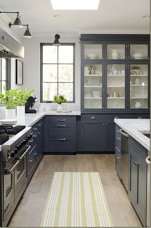wouldn't want color to be this country (and probably darker) and not traditional cabinets...  LOVE the window.