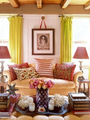 Don't feel confined by period pieces when decorating an entire space; Offset stately furnishings with assured playful colors, like rosy pinks and crisp greens. Chartreuse curtains and a red lampshade help to balance out the seriousness of the 18th-century English sofa in this living room. What you're left with is a decadent interior that's both lustrous and cozy.
