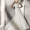 Puntal strapless lace wedding dress in a more classic A-line style.
