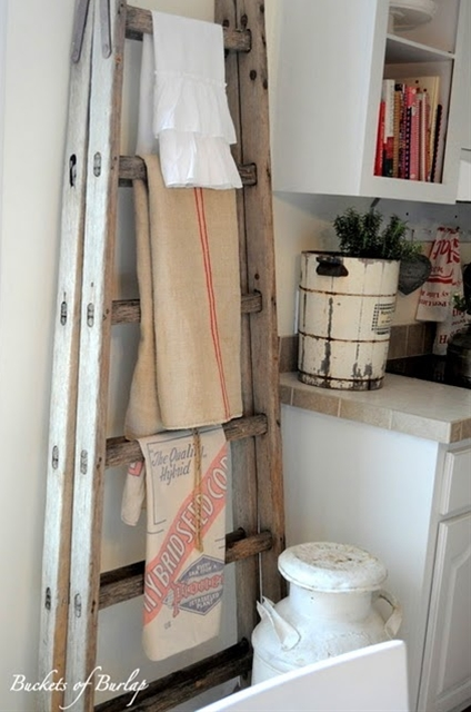 Old ladder as towel rack