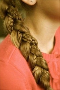 Super easy cute hairstyle . Braid a small price of your hair and then add it in to one of the three strands in a regular braid to the side .