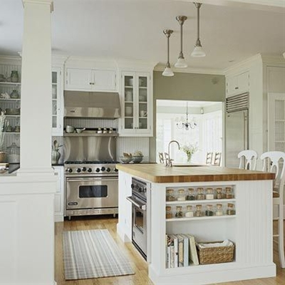 butcher block island, open floor plan, upper shelving, spice storage, oven in island.