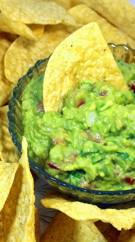 Ingredients:  2 Medium (about 2 Cups) Onion, Fine Dice,  3 Medium Limes, Zest and Juice,  4-6 Medium (about 2 Cups) Tomatoes,  1 Cup Fresh Cilantro Leaves, chopped,  2 Medium Jalapeno Peppers, Stems, Seeds  and inner white ribs removed, Fine Dice,  The Secret Ingredient - 1 Small can (8 Oz) Crushed Pineapple in Natural Juices,  12 Medium (about 8 Cups) Avocados, Cut in half, Pit removed and scooped out of shell. Crushed into paste