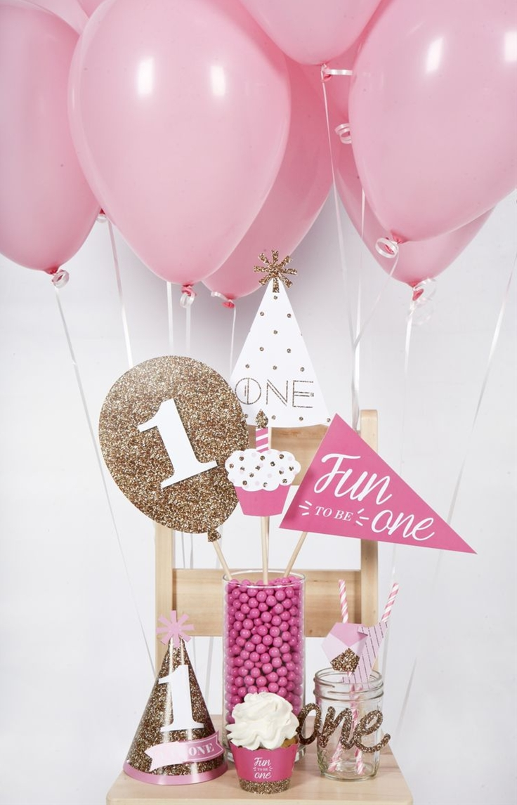 Your little lady is turning one and you want to style an amazing first birthday party. The Fun to be One – 1st Birthday Girl party theme is perfect for your event. With pretty pinks and glittery gold accents, this first birthday party theme is just right for any baby girl. A first birthday smash cake kit will get the party started while a custom banner and pink balloons provide the perfect backdrop for your party photos. Your friends and family will have a great time celebrating a girl's 1st birthday party and are sure to be impressed with your stylish party décor.