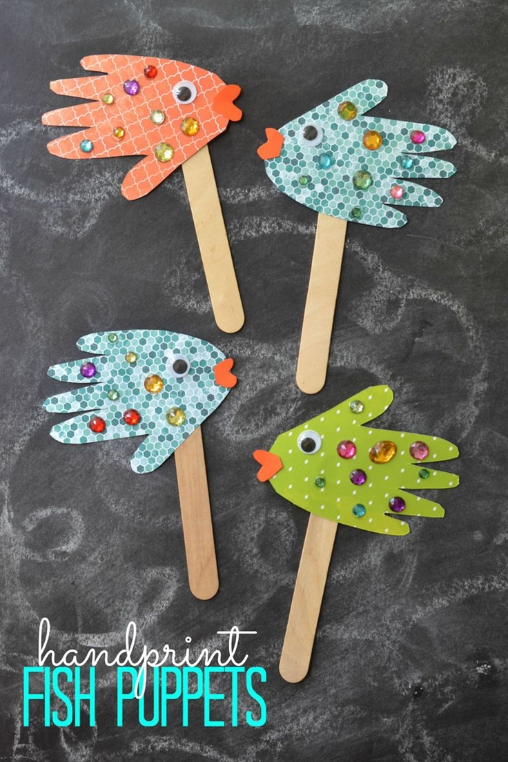 """So what are you waiting for? Grab your craft supplies and get to work on helping your child make their very own """"school of fish"""" today! Don't forget to make a few pieces using your handprints too! Happy crafting and pretend playing, my friends!\n\n Here's what you'll need:\n  Scrapbook Paper/Cardstock Paper\n Rhinestones\n Popsicle Sticks\n Pencil\n Scissors\n Wiggle Eyes\n Glue"""