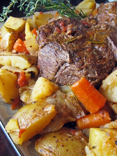 INGREDIENTS: 1 3-4 lb. beef chuck roast, trimmed of excess fat,  salt and freshly ground black pepper,  3 Tbsp. extra virgin olive oil,  1 (14 oz.) can crushed tomatoes (I used fire-roasted),  1 cup water,  2 yellow onions, thickly sliced,  2 large cloves garlic, chopped,  2 celery stalks, sliced,  carrots, peeled and chopped (as many as you can fit in the pot),  Yukon gold potatoes, chopped (as many as you can fit in the pot),  2 sprigs fresh rosemary,  4 sprigs fresh thyme,  2 bay leaves.