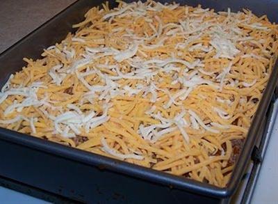 Ingredients:  2 lbs ground beef,  3 low carb tortillas (18g carbs/12g fiber = 6g net carbs each),  1 1/2 enchilada sauce (3g per 1/2 C),  cheese,  seasonings (salt, pepper, garlic, italian mix).
