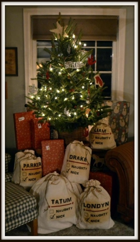 Muslin Drawstring bags with a stenciled name- gifts from Santa....love this idea!#Repin By:Pinterest++ for iPad#