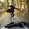 Heath Ledger doing a kick flip over Christian Bale on set during...