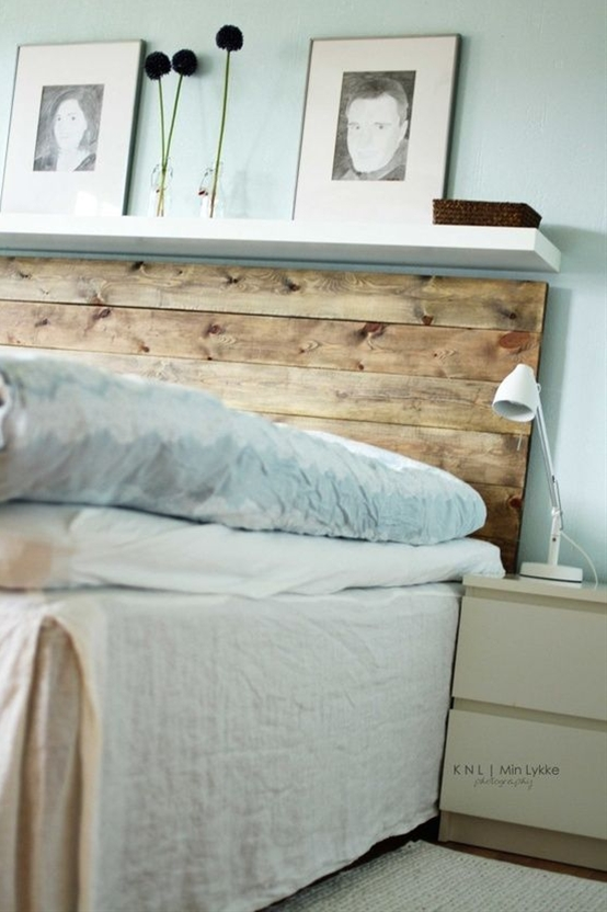 I love the fact that this headboard was made with new wood that was made to look old with stain.  It is a very simple construction and you can even get the wood cut to size at a home improvement store if you need to.  The added white shelf adds a nice amount of chic.