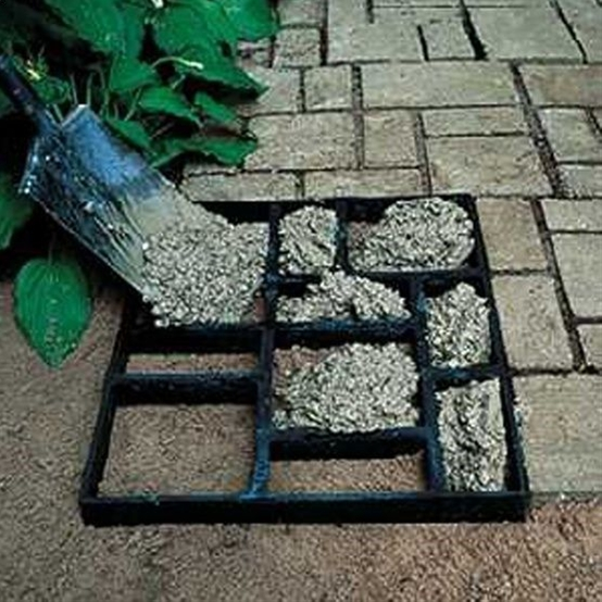 use a picture frame with multiple spaces, and a bag of cement. Prettier and cheaper way to do a walk.