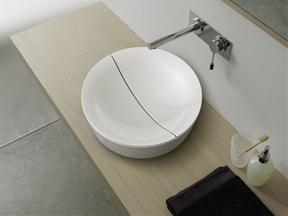 Scarabeo Reinterprets the Common Sink Drain Design