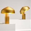 Aura desk lamp by Ross Gardam features a rotating gold shade