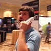 Guy who's been on hold for 16 years raids a call center convention in Las Vegas to get some answers.