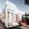 "House by Philip Stejskal can be ""locked down"" with shutters that blend into the facade"