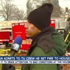 Man calmly approaches news crew outside burning building and admits to setting it on fire.