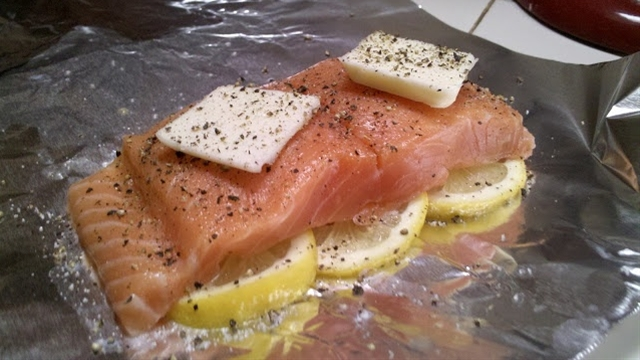 Ingredients: 2 salmon filets, thawed,   1 whole lemon,  4 slices of butter (I probably used about a tablespoon per filet, but you can use more or less),  4 cloves garlic, minced and crushed,  salt and freshly ground pepper.