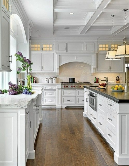 This is a fantastic kitchen. How could anyone complain about this space, right? Oh, I would love to have this roomy white kitchen…  Great combination of white marble and dark-stained butcher's block countertop. Very elegant.