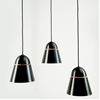 Aluminium and timber light shades by Nick Sadowsky use gravity to maintain shape