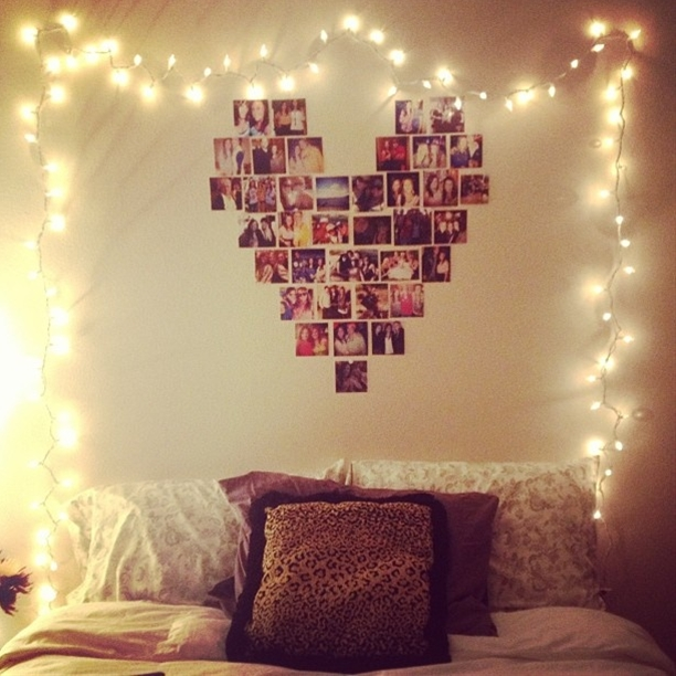 I really like this idea. Especially with the twinkle lights. My only OCD problem with it would be making the photos have the same filter & be the same size.