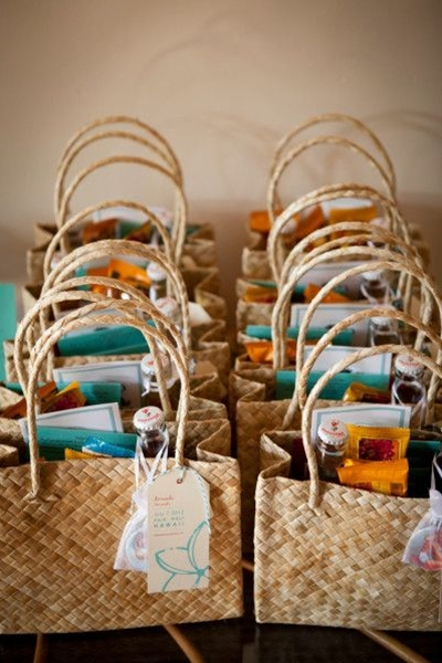 When guests travel for your destination wedding, it's a nice gesture to greet them with a welcome bag, also known as an out of town bag, full of gifts and supplies they can use during their visit. The welcome bags can have just about anything in them from food to helpful information to first aid supplies. No matter what you decide to put in your destination wedding welcome bags, they will be greatly appreciated by all of your wedding guests.