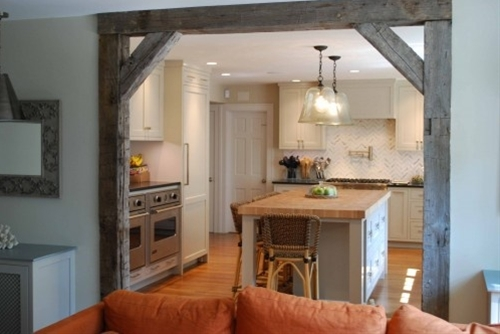 reclaimed barnwood to frame an entry...Someday I'd love to turn my kitchen into something a little more Tuscan, with faux stone walls. This could be a great finishing touch for the openings...