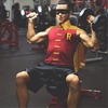 JGL doing shoulder presses in Robin costume