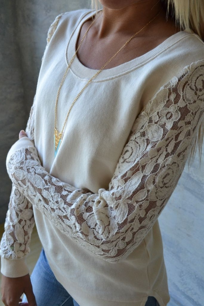 Delicately feminine lace-sleeved top.  A unique and classy twist on a casual staple.