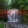 Pier Fabre suspends red strings over waterfall pool for Dripping installation