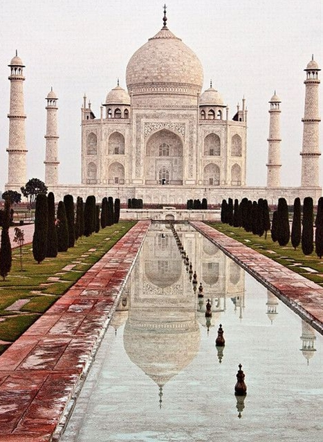"""Taj Mahal was built by a Muslim, Emperor Shah Jahan (died 1666 C.E.) in the memory of his dear wife and queen Mumtaz Mahal at Agra, India. It is an """"elegy in marble"""" or some say an expression of a """"dream."""" Taj Mahal (meaning Crown Palace) is a Mausoleum that houses the grave of queen Mumtaz Mahal at the lower chamber. The grave of Shah Jahan was added to it later. The queen's real name was Arjumand Banu. In the tradition of the Mughals, important ladies of the royal family were given another name at their marriage or at some other significant event in their lives, and that new name was commonly used by the public. Shah Jahan's real name was Shahab-ud-din, and he was known as Prince Khurram before ascending to the throne in 1628."""