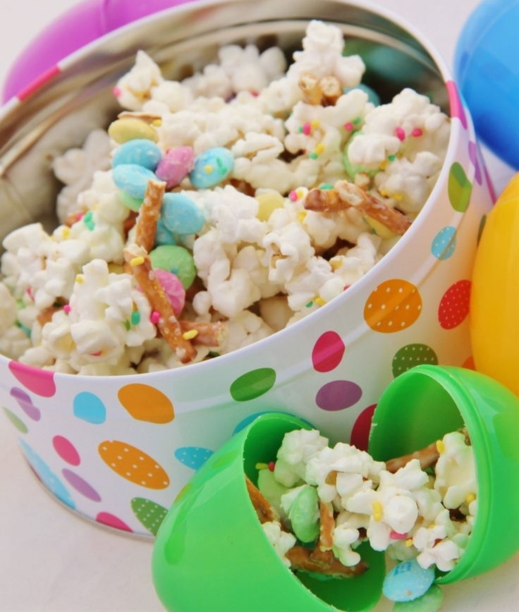 Ingredients: 1 bag popcorn, popped (non-buttery type is best),  7 oz. almond bark,  1 bag Easter M&Ms,  pretzel sticks, broken into small pieces colorful sprinkles, if desired.