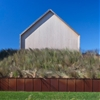 Shingle-clad house by Bates Masi Architects mimics Long Island potato barns