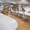 """Clive Wilkinson's office for The Barbarian Group is """"one huge table through a room"""""""