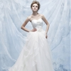Sweetheart neckline gown with beaded bodice and full tiered skirt