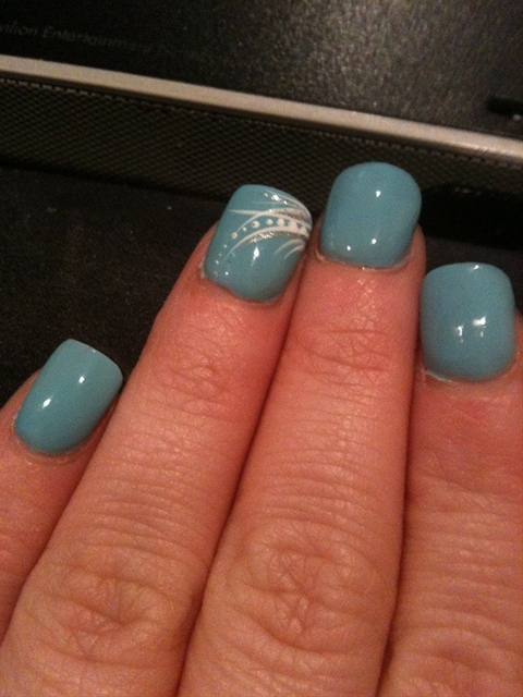 Blue nails with pretty design on ring finger!